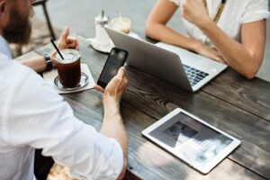 Professionals networking with laptops and mobile devices