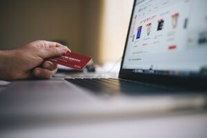 Online shopping concept with laptop and credit card